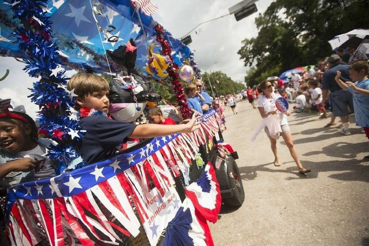 Parade participants wave at guests during a past Kingwood Fourth of July parade.