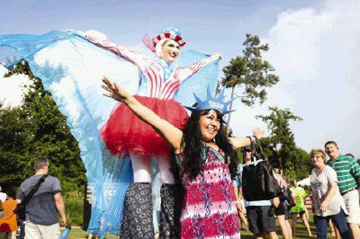 Rocio de la Rosa, right, poses with Anna Vlada, a performer with J&D Entertainment, during the Red Hot and Blue Festival on July 4, 2015 at Town Green Park.