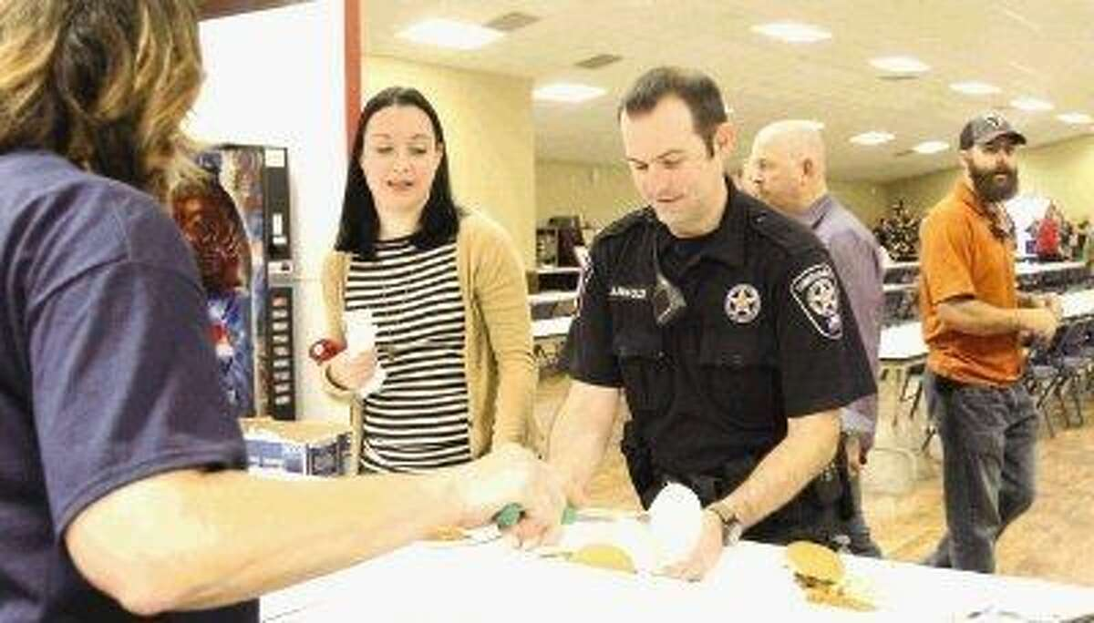 Visitors dined on barbecue and bid on silent auction items during Saturday's fundraiser at Bull Sallas Park Friendship Center in New Caney. The fundraiser benefited Montgomery County Sheriff's Office Senior Sgt. Jack Valenzuela and Deputy Robert Layman, who were hit by a car Nov. 5 after helping a stranded motorist.