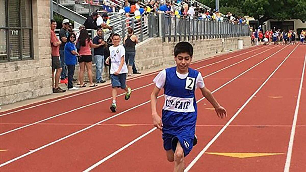 Arnold Middle School track and field athlete Richie Costa crosses the finish line during a Special Olympics competition this year.