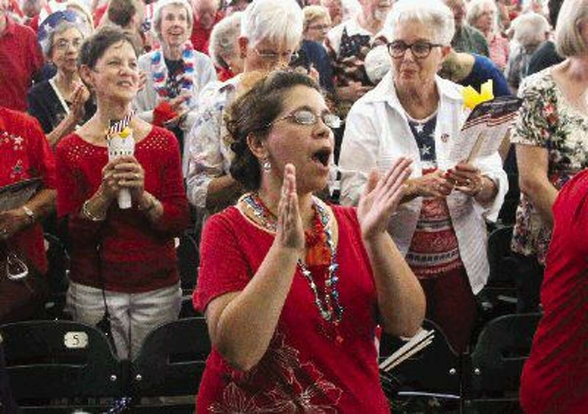 Isis Rosales cheers during the Star-Spangled Salute presented by the Houston Symphony July 3, 2015 at The Cynthia Woods Mitchell Pavilion. More than 11,000 visitors enjoyed music from the Houston Symphony during the annual event.