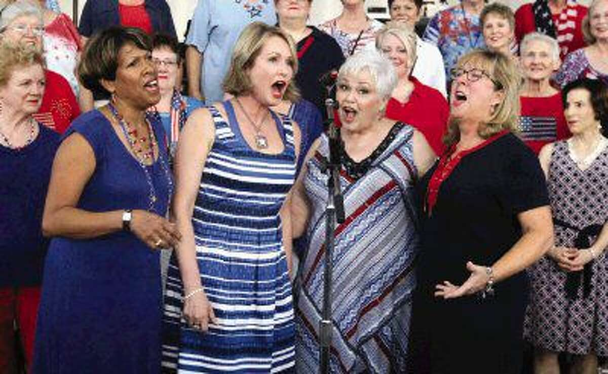 Singers perform during the Star-Spangled Salute presented by the Houston Symphony July 3, 2015 at The Cynthia Woods Mitchell Pavilion.
