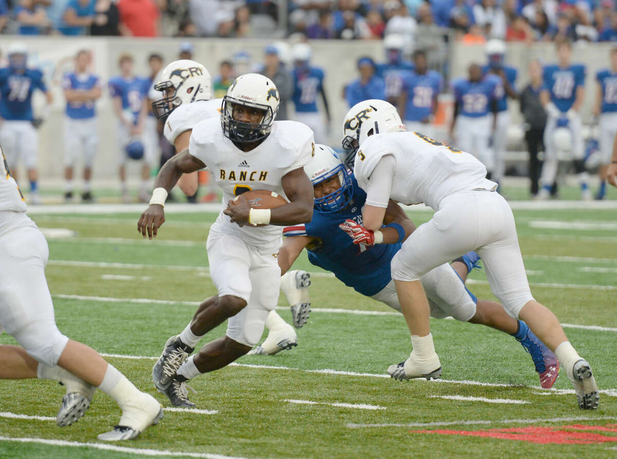 Cypress Ranch running back Chandler Thomas goes through a hole in the second half of the Division I Region III-6A final against Dickinson on Saturday.