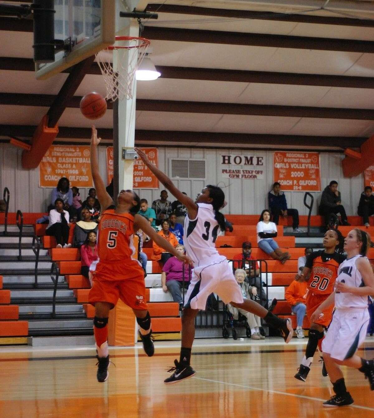 Goodrich junior Kristian James makes a layup on a breakaway drive during the Lady Hornets win over Hemphill's Lady Hornets to take third place in the Goodrich Basketball Tournament, Dec. 6, 2014.