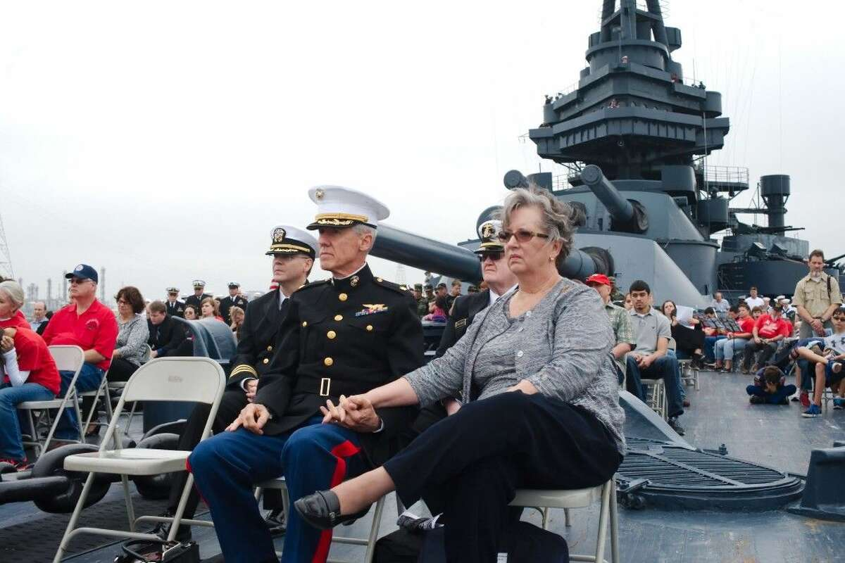 Current and former servicemen and women and family members along with local citizens gather on the deck of the Battleship Texas Saturday, Dec. 6. during a memorial service for those that served and died in the attack at Pearl Harbor December 7, 1941.