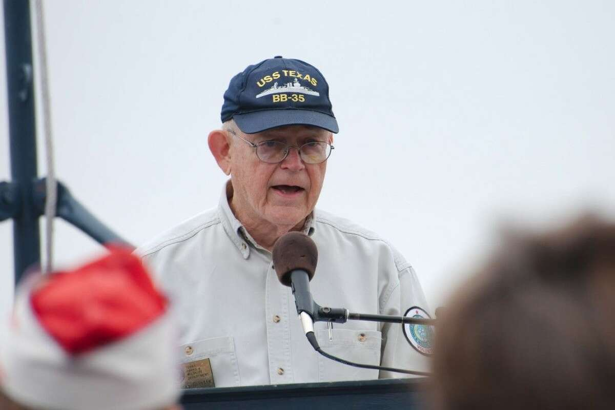 Former Navy officer Thomas Gillette recalls being ten-years-old and living near the Pear Harbor Naval Station as the Japanese attack planes flew over his house in route to attack the base on December 7, 1941 during a memorial service on the deck of the Battleship Texas Saturday, Dec. 6.