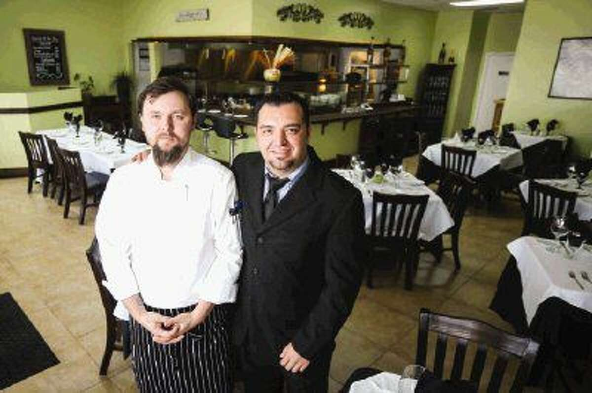 Art Huerta, right, owns Papa Amadeus, an Italian restaurant in Spring, and works with head chef Maksym Oliynyk to ensure fine New-York style cuisine is served at affordable prices in a neighborhood environment.
