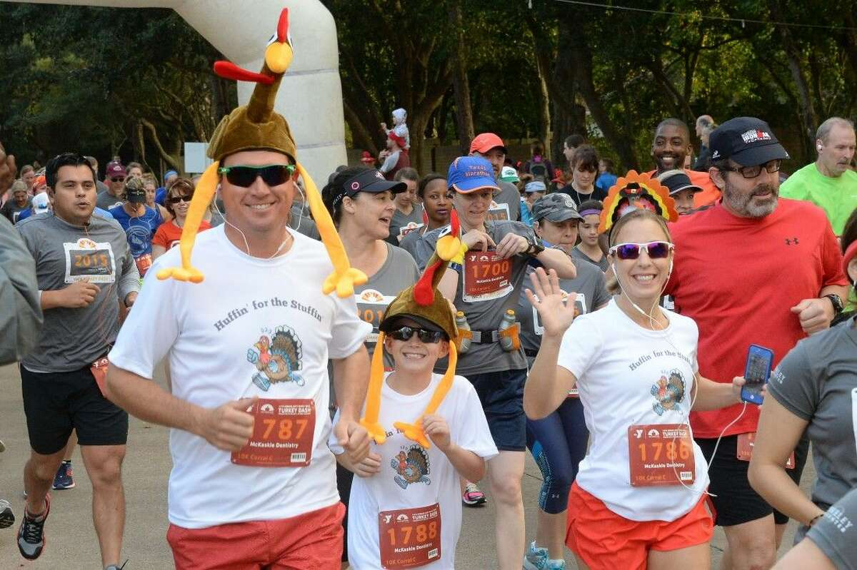 A family decked out in turkey headdresses takes off from the starting line of Thursday's YMCA Katy Turkey Dash. Hundreds of residents sported their favorite Thanksgiving attire.