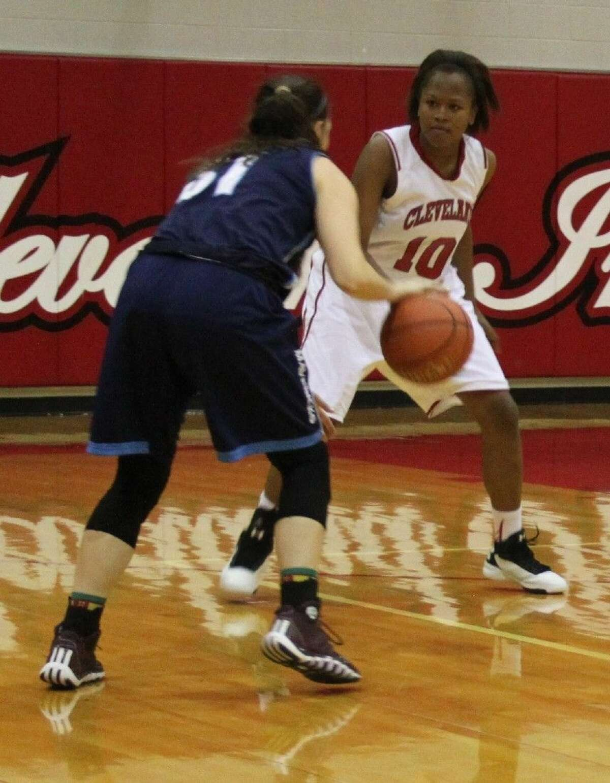 Tytiana Haamid (10) prepares to defend against one of the Lady Mavericks.