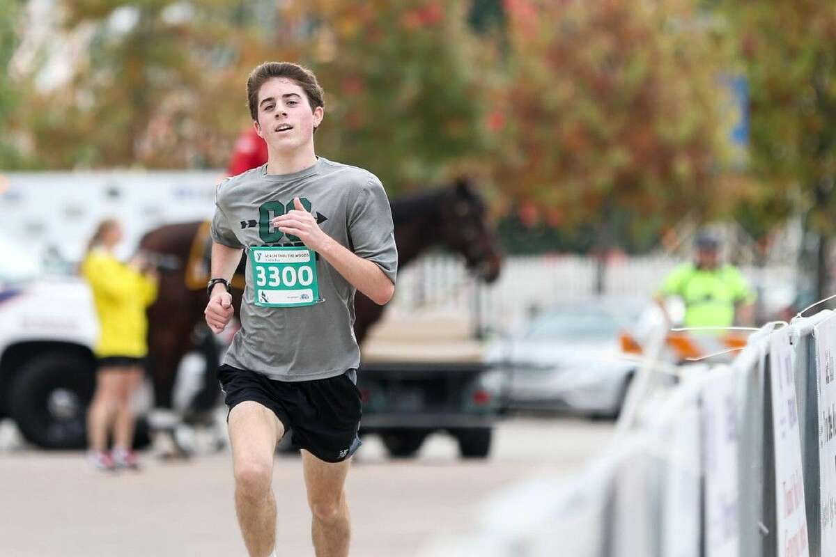 The Woodlands resident Ryan Muller, 18, runs for the finish in the 26th annual GE Run Thru The Woods Thursday. Muller finished the three mile race first in 15 minutes and 48 seconds.
