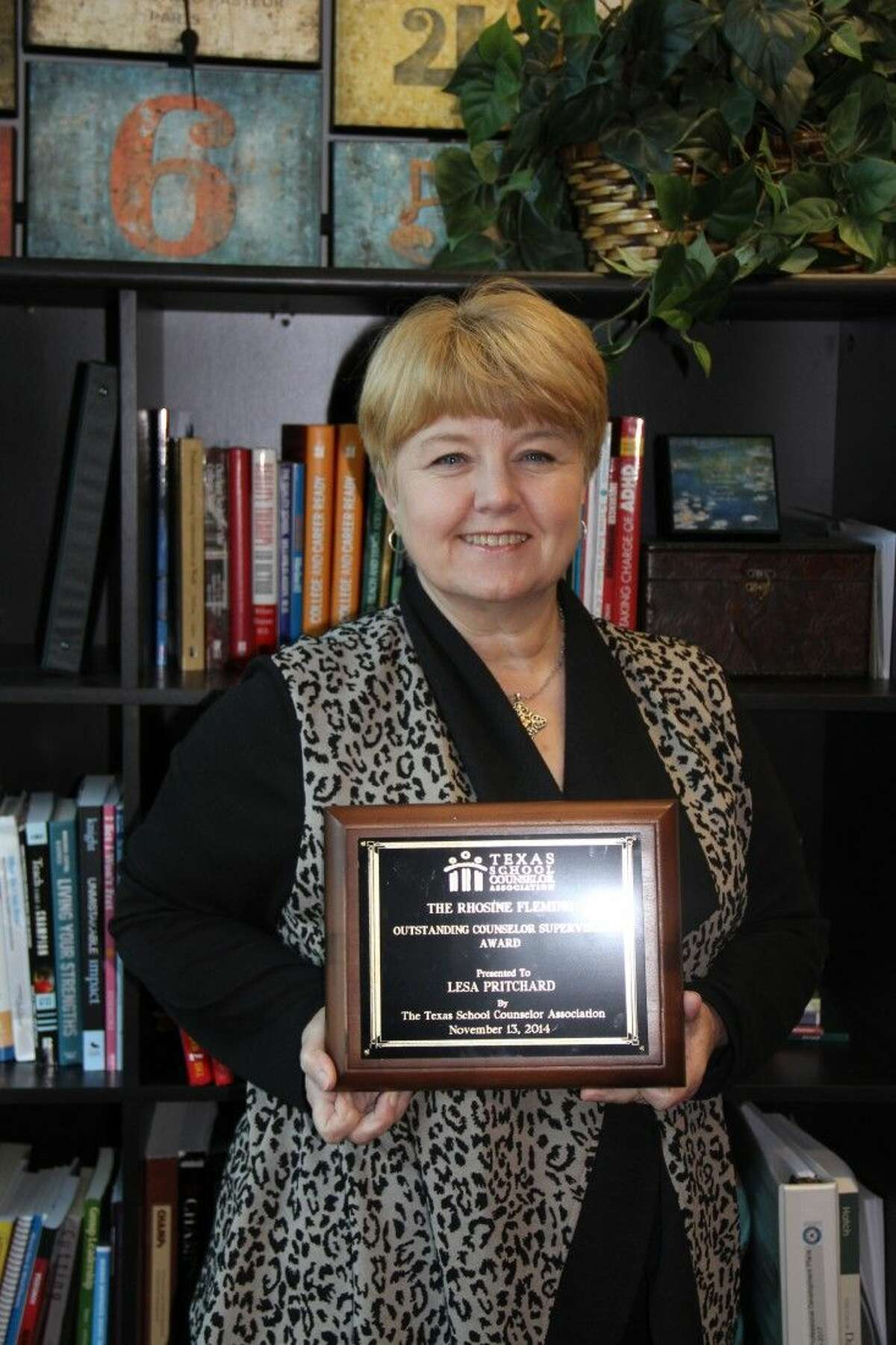 Lesa Pritchard, Humble ISD Director of Student Services receives Supervisor of the Year award by the Texas School Counselor Association.