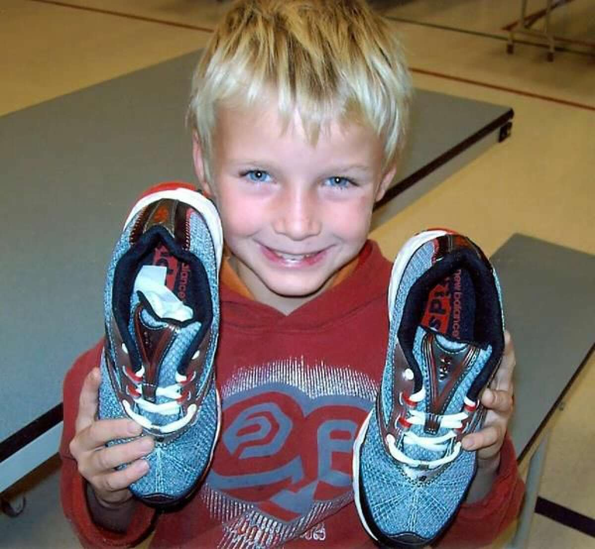 Giving to Shoes That Fit helps students attend school with confidence.