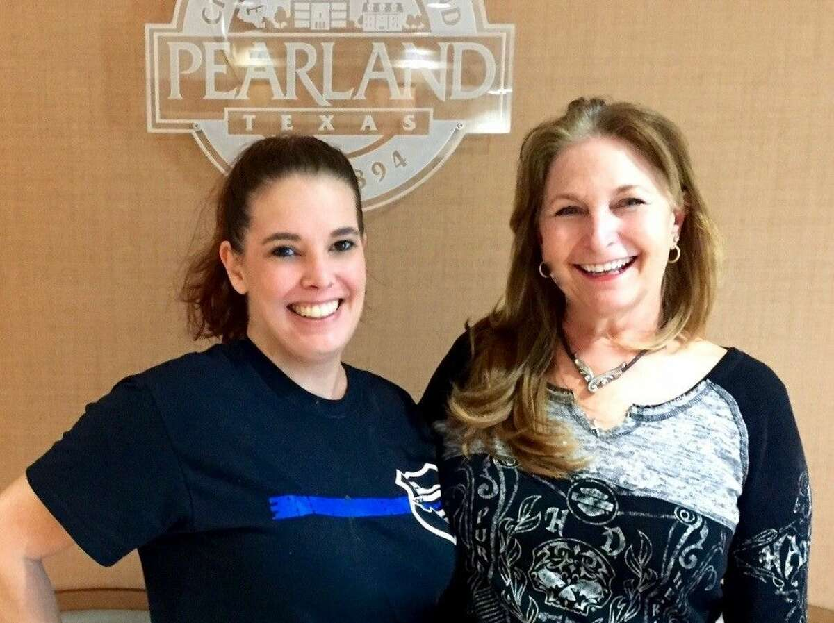 Connie Knox (R) delivers the donations to Board Member Stacey Glaesmann at the Pearland Police Department.