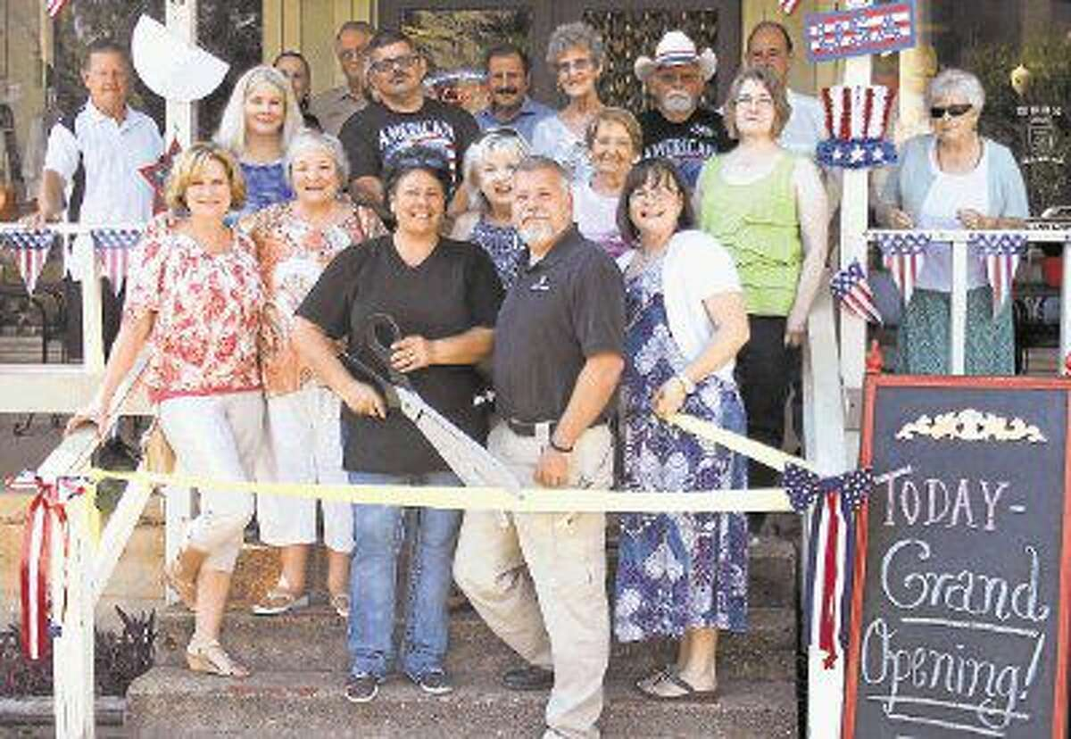 J. Dale Young prepares to cut the ribbon to commemorate the Mason Jar joining the Coldspring/San Jacinto County Chamber of Commerce on June 23.