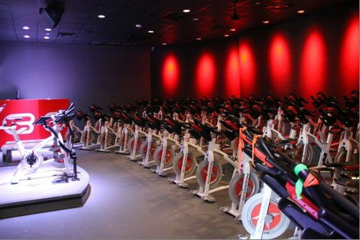 CycleBar's Cycle Theatre where riders experience a high-energy workout with loud music and graphics.