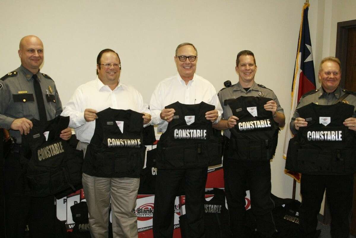 """From left, Montgomery County Precinct 4 Constable Kenneth """"Rowdy"""" Hayden, The 100 Club Board of Directors' President Ted Lyons, The 100 Club Executive Director Rick Hartley, Pct. 4 Deputy James Slack and Pct. 4 Chief Barry Welch pose with the new body armor on Dec. 8, 2014 which was provided through The 100 Club."""