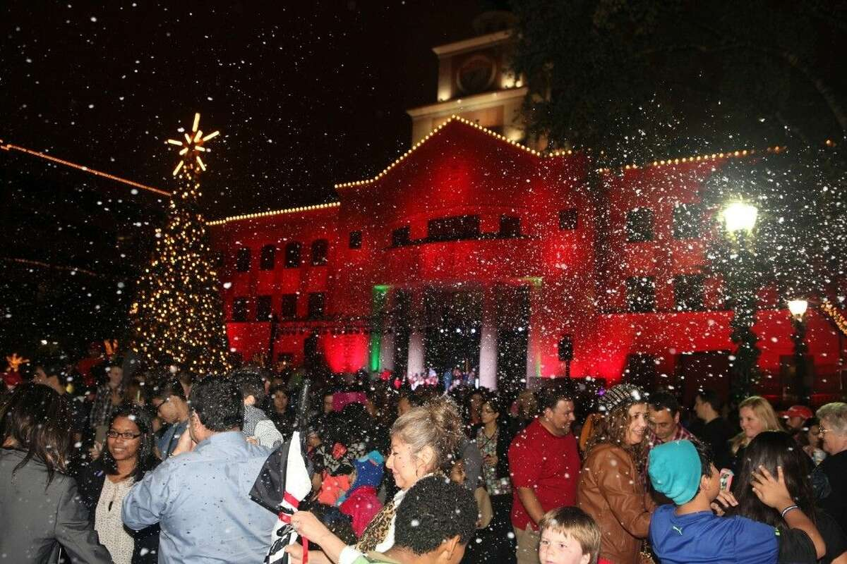 Artificial snow fills the air during the 12th annual Christmas Tree Lighting at Sugar Land Town Square on Thursday, Dec. 4.
