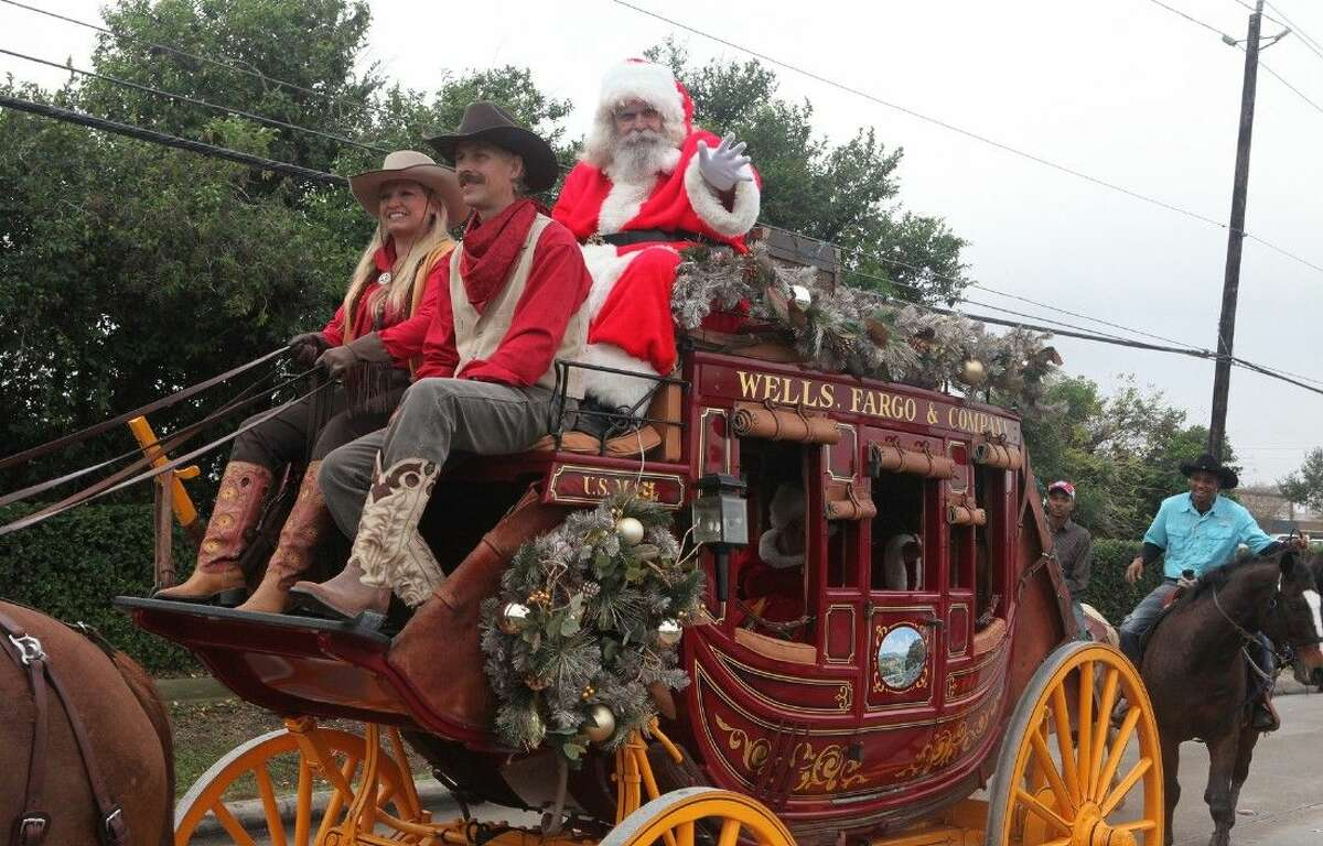 Santa rides on the Wells Fargo & Company wagon in the Missour City's Snowfest Parade on Saturday, Dec. 6.