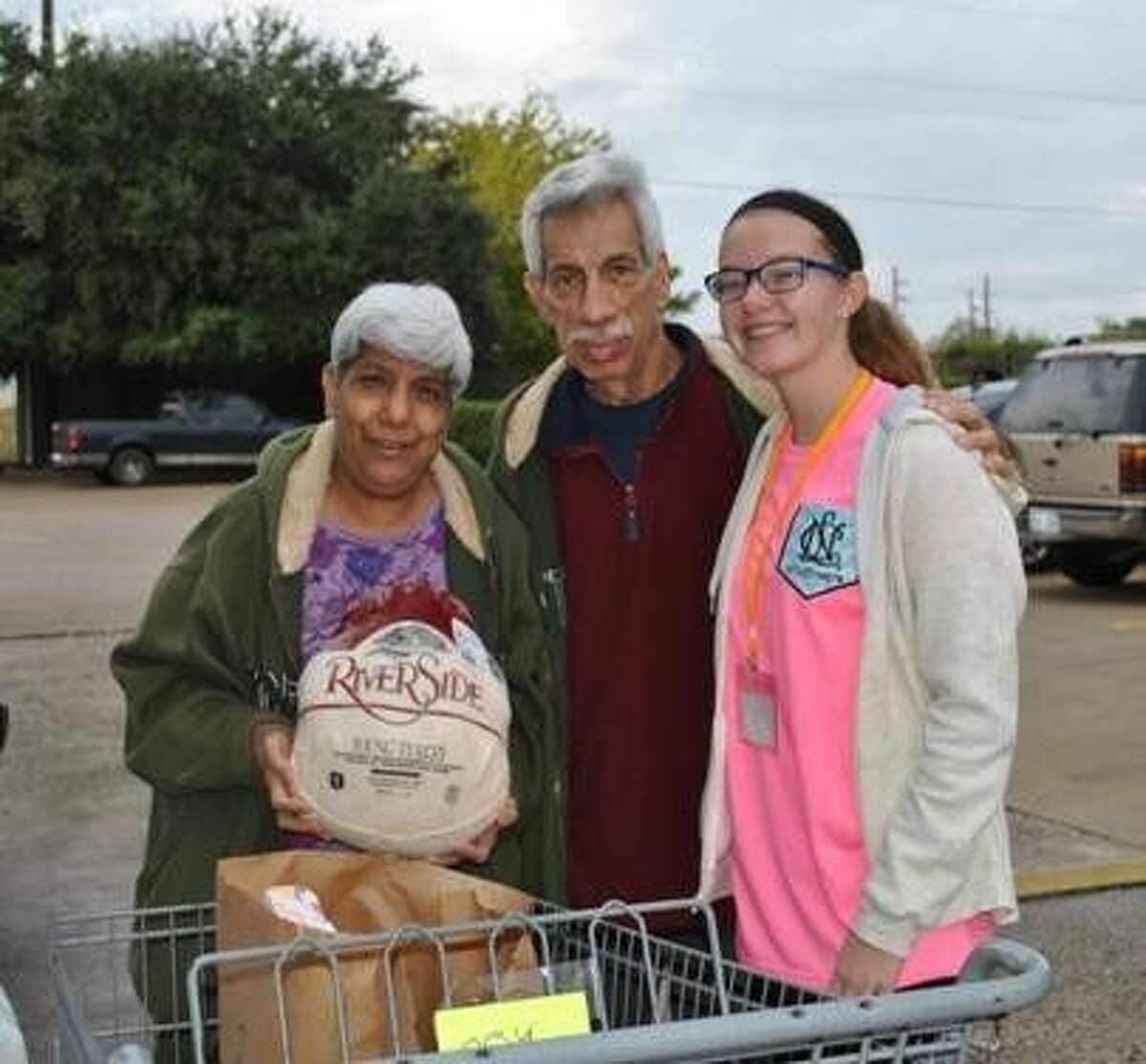 Volunteers helped distribute Thanksgiving meals to more than 800 local families through the Holiday Project at Northwest Assistance Ministries.