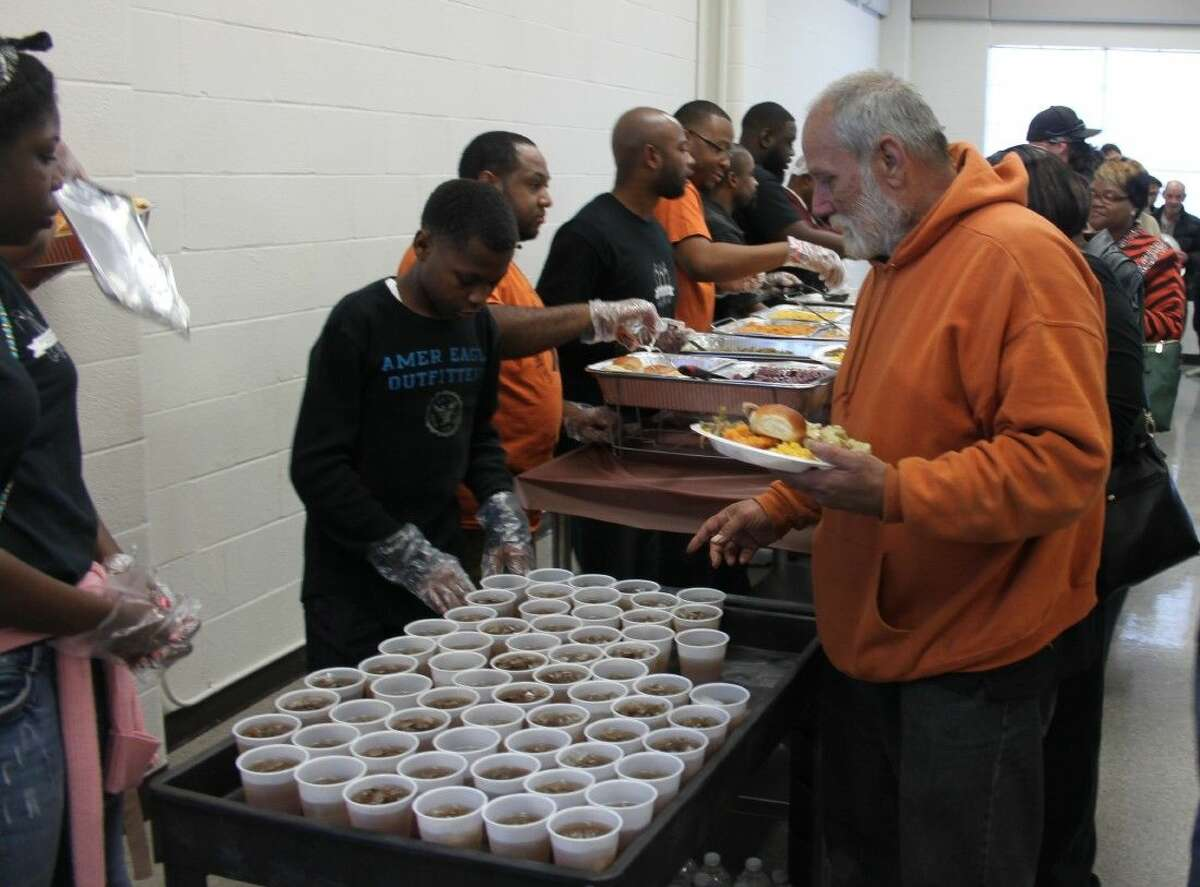 Citizens of Coldspring line up to be served a hot meal at the Coldspring Community Feast.