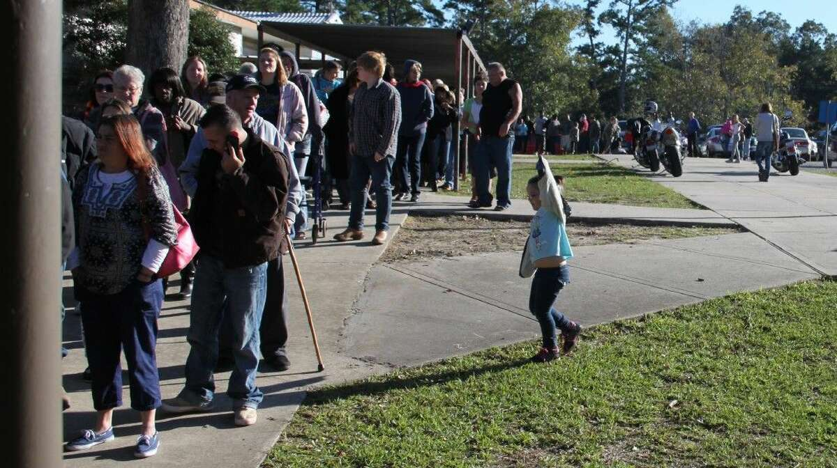 A line forms outside of the Jones Auditorium to be served a hot meal and items to use to prepare for Thanksgiving, all part of the Coldspring Community Feast.