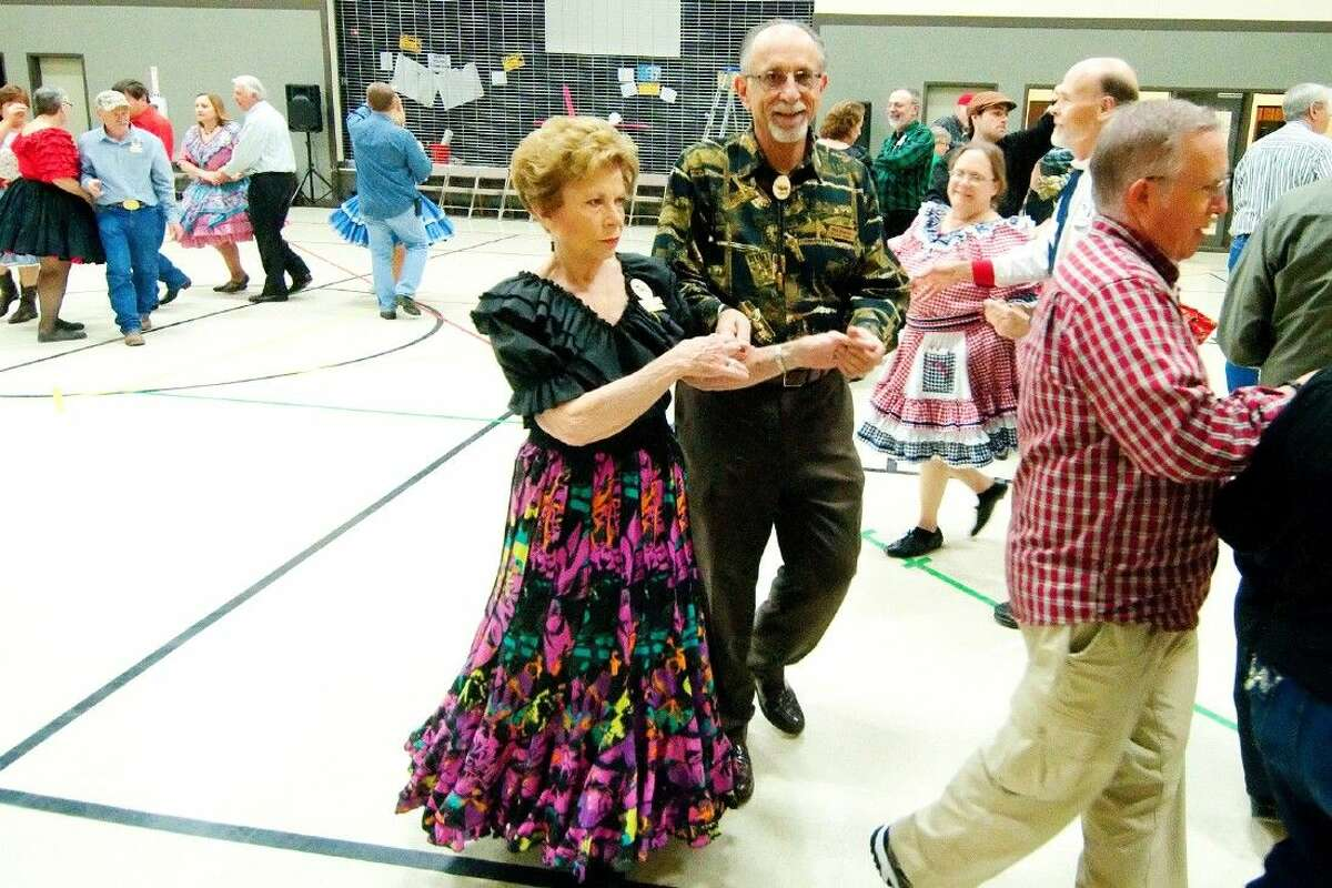 Peggy Wilson and Ron Kissner enjoy square dancing at a Thursday night meeting with the Tomball Sesquicentenial Promenders on Dec. 4, 2014.