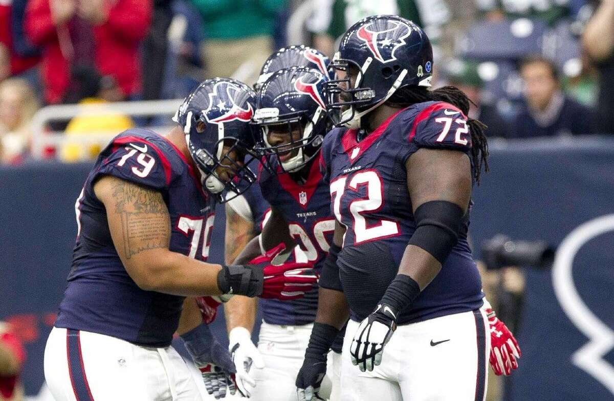 Houston Texans running back Alfred Blue, center, celebrates with teammates after catching a 21-yard touchdown pass from Cecil Shorts last Sunday against the New York Jets.