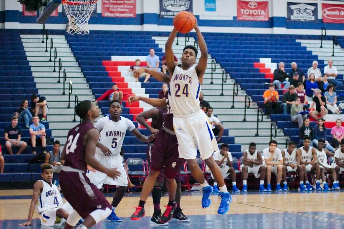 Elkins' Bryce Terrell (24) pulls down a rebound against Clear Creek in the final game of the Carlisle-Kruger Classic Dec. 6.