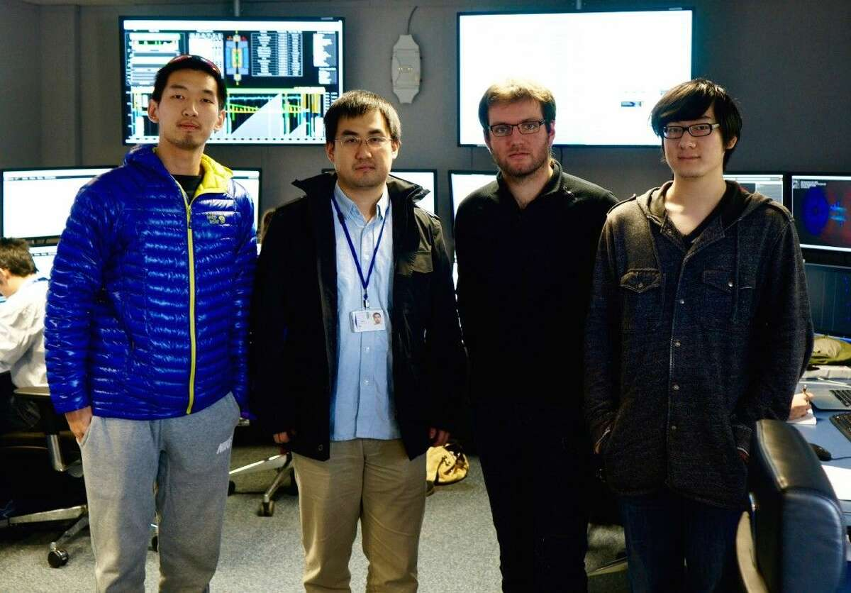 Members of the Rice University team take a break at the Compact Muon Solenoid control room at CERN this week. From left: Zhoudunming Tu, Wei Li, Maxime Guilbaud and Zhenyu Chen.