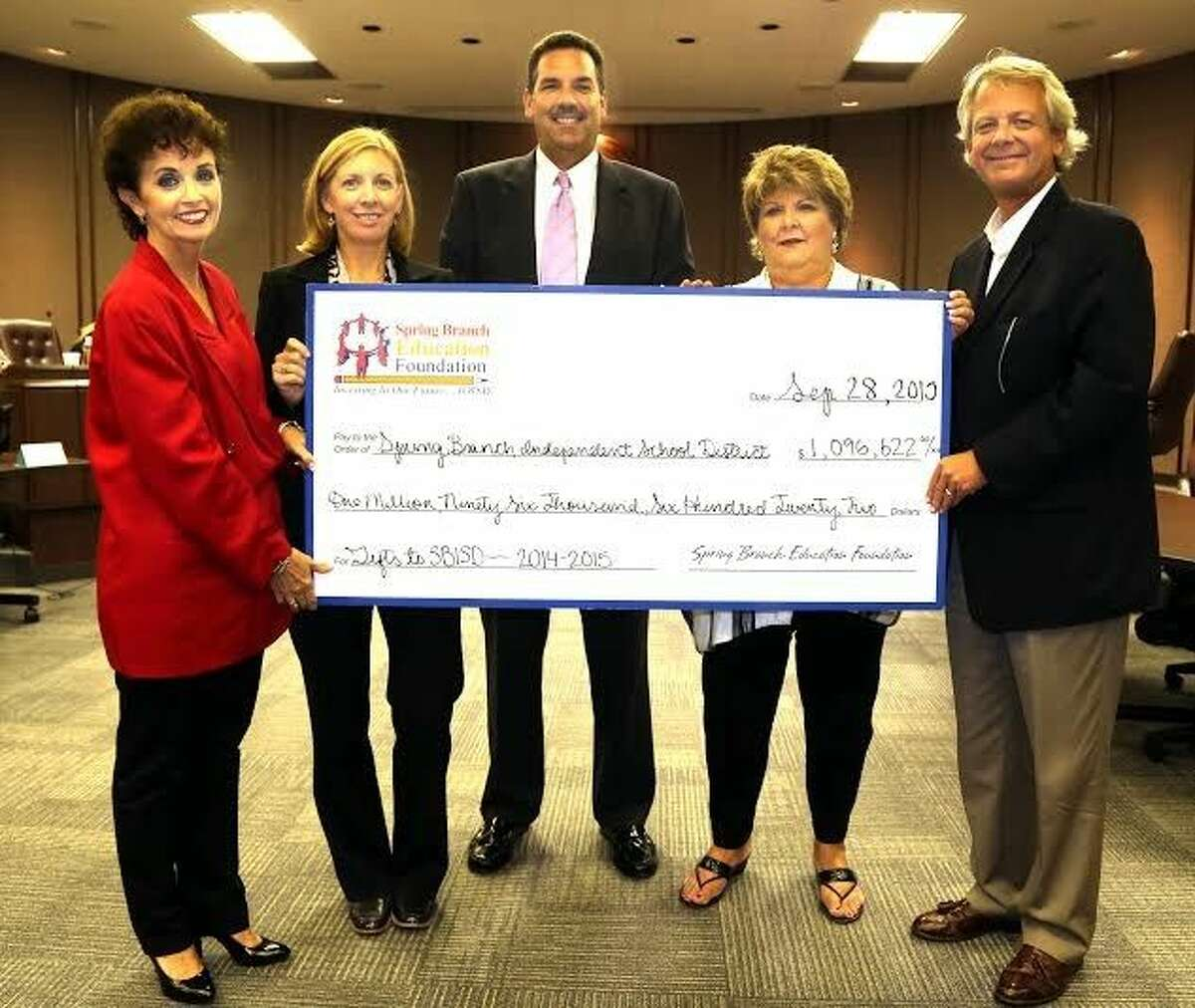 In 2014-15, SBEF donated more than $1 million to SBISD. The district's trustees unanimously approved a resolution expressing gratitude for the Foundation's service to the district. Lisa Schwartz, chair, SBEF Board; Chris Vierra, president, SBISD Board of Trustees; Dr. Scott R. Muri, superintendent, SBISD; Cece Thompson, executive director, SBEF; J. Carter Breed, SBEF board member.