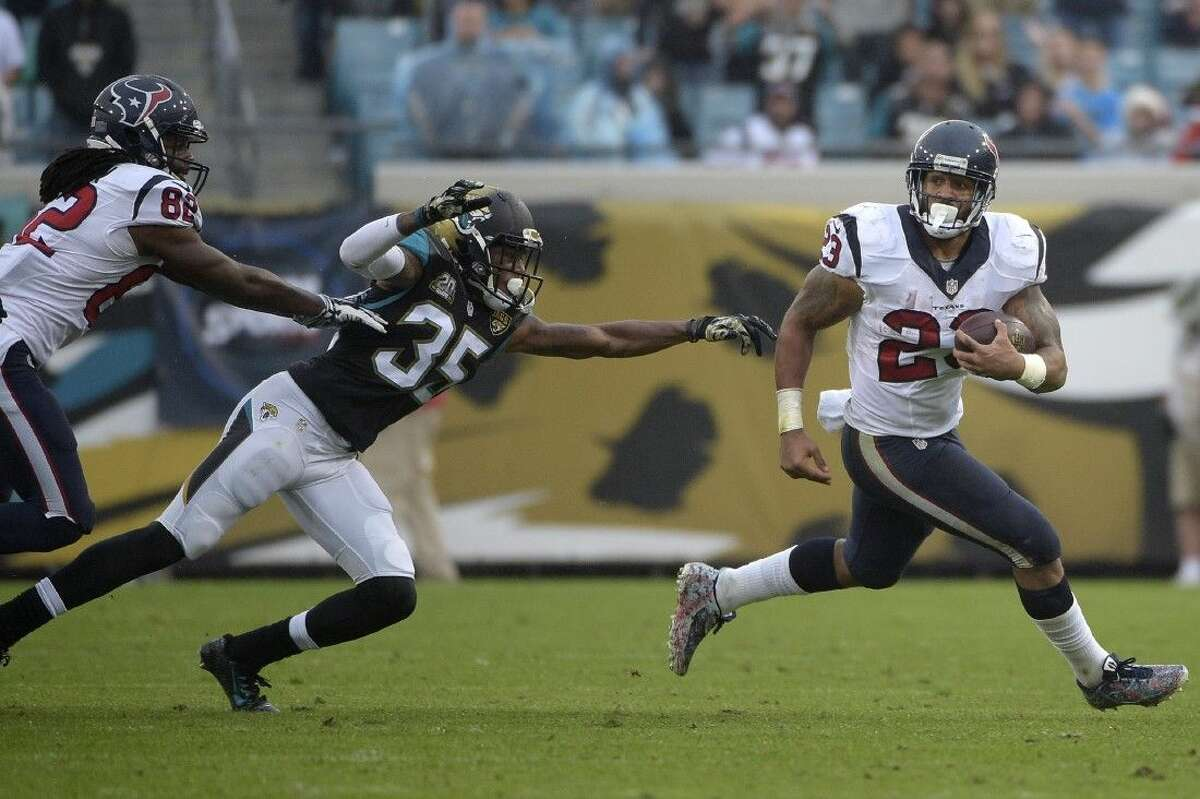 Texans running back Arian Foster rushes for yardage against Jacksonville as wide receiver Keshawn Martin (82) blocks downfield. The Texans travel to play the Colts on Sunday.
