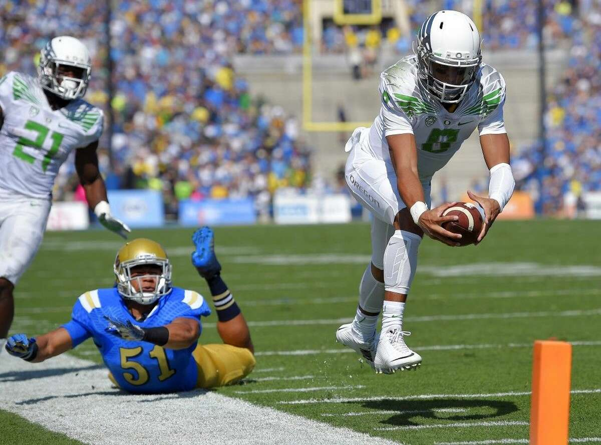 Oregon quarterback Marcus Mariota is the clear favorite to win the Heisman Trophy.