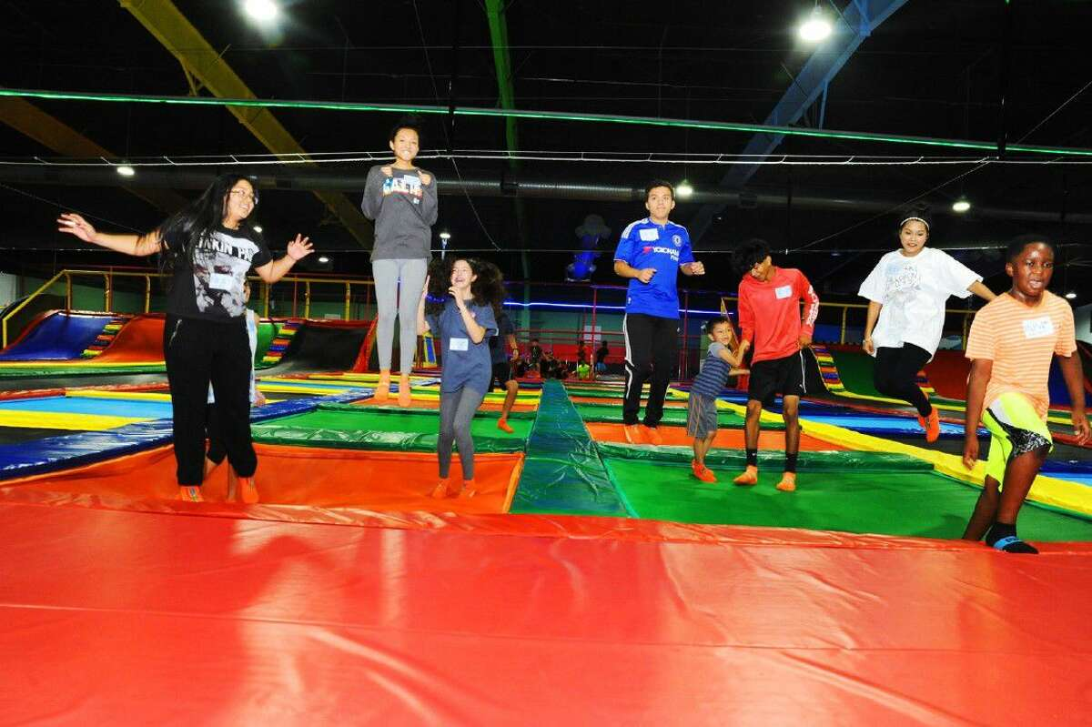 Children of all ages jumping on the trampolines at Bounce Bounce Park.