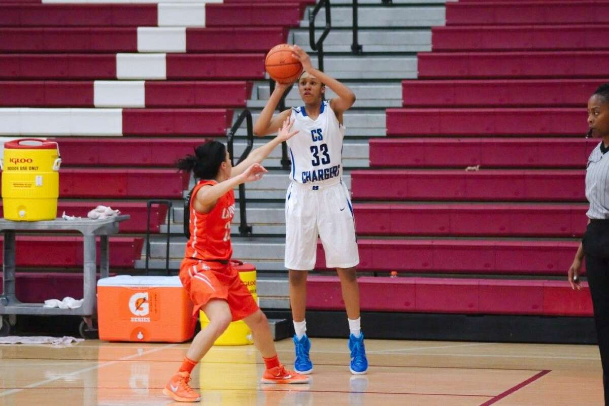 Clear Springs' Sierra Cheatham (33) launches a shot over La Porte's Nicole Covarrubias (25) in the Peggy Whitley Classic basketball tournament last week.