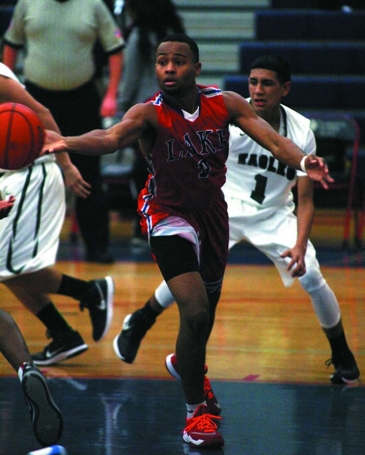 Orion Lewis of Clear Lake passes the ball against Pasadena last week in the Carlisle-Krueger Classic.