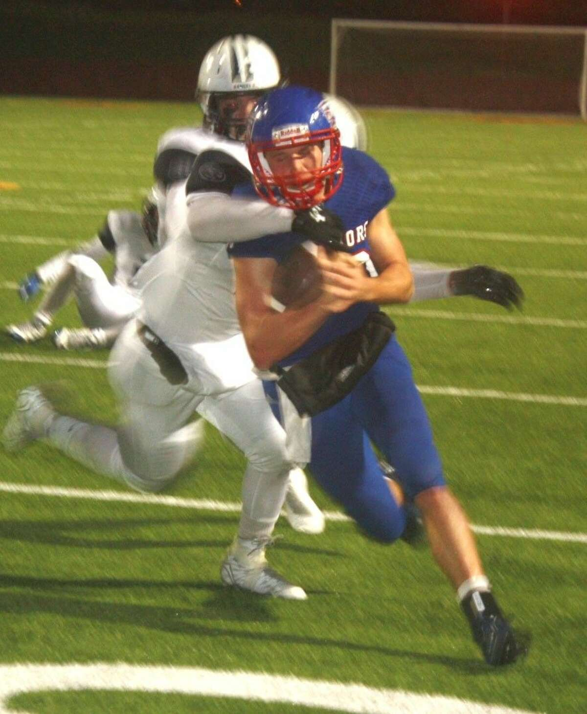 FBCA's Brett Houston finds some more tough yardage in the TAPPS state semifinal Division I 6-man game at Deer Park High School's Clyde Abshier Stadium last Saturday night. Houston, who will be up for All-State honors based on his 50-plus touchdowns this season, scored all of the Warriors TDs in the 40-30 loss to Emery.