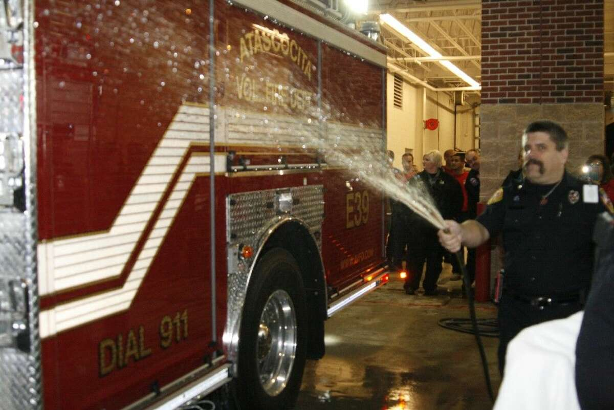 Per tradition, they hose down the new Engine 39 on Dec. 8, 2014.