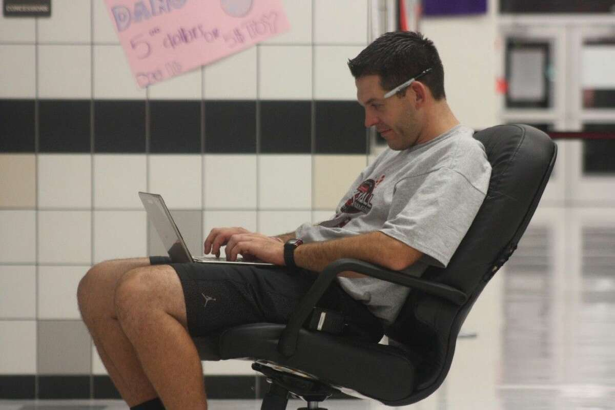 Ryan Nygaard, a 1996 Deer Park graduate who collected First Team All-District honors, takes a seat outside a San Jacinto Intermediate gym after the crowds have left and types in tournament scores to the website from one of his recent events. He'll be crunching more numbers Friday and Saturday as the 10th annual event arrives this month and next. Deer Park, Bonnette and Deepwater will be competing in the 68-team tourney.
