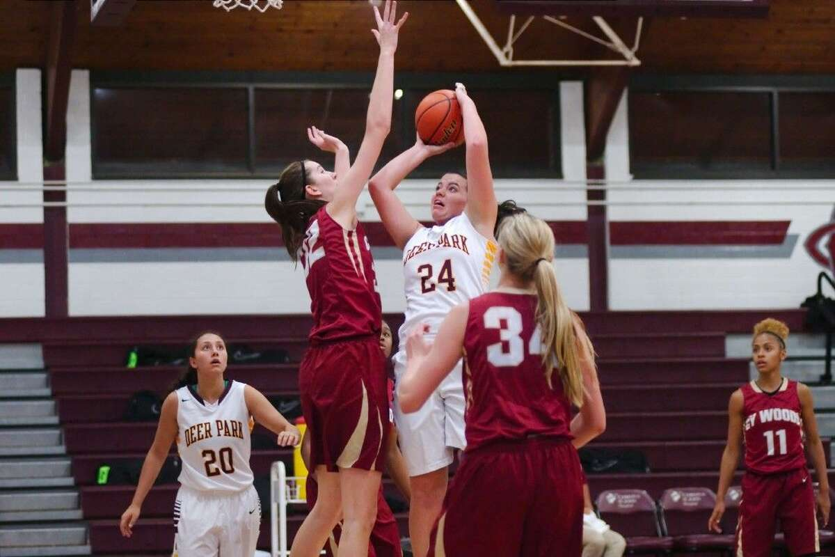 Deer Park's Liane Moser attempts a jumper during the team's opening game of the Peggy Whitley Classic at Clear Creek High School last Thursday. Cypress Woods, with its 6-foot-8 Nancy Mulkey, was too much for the maroon and gold as the club spent the rest of the tournament fighting for consolation honors.