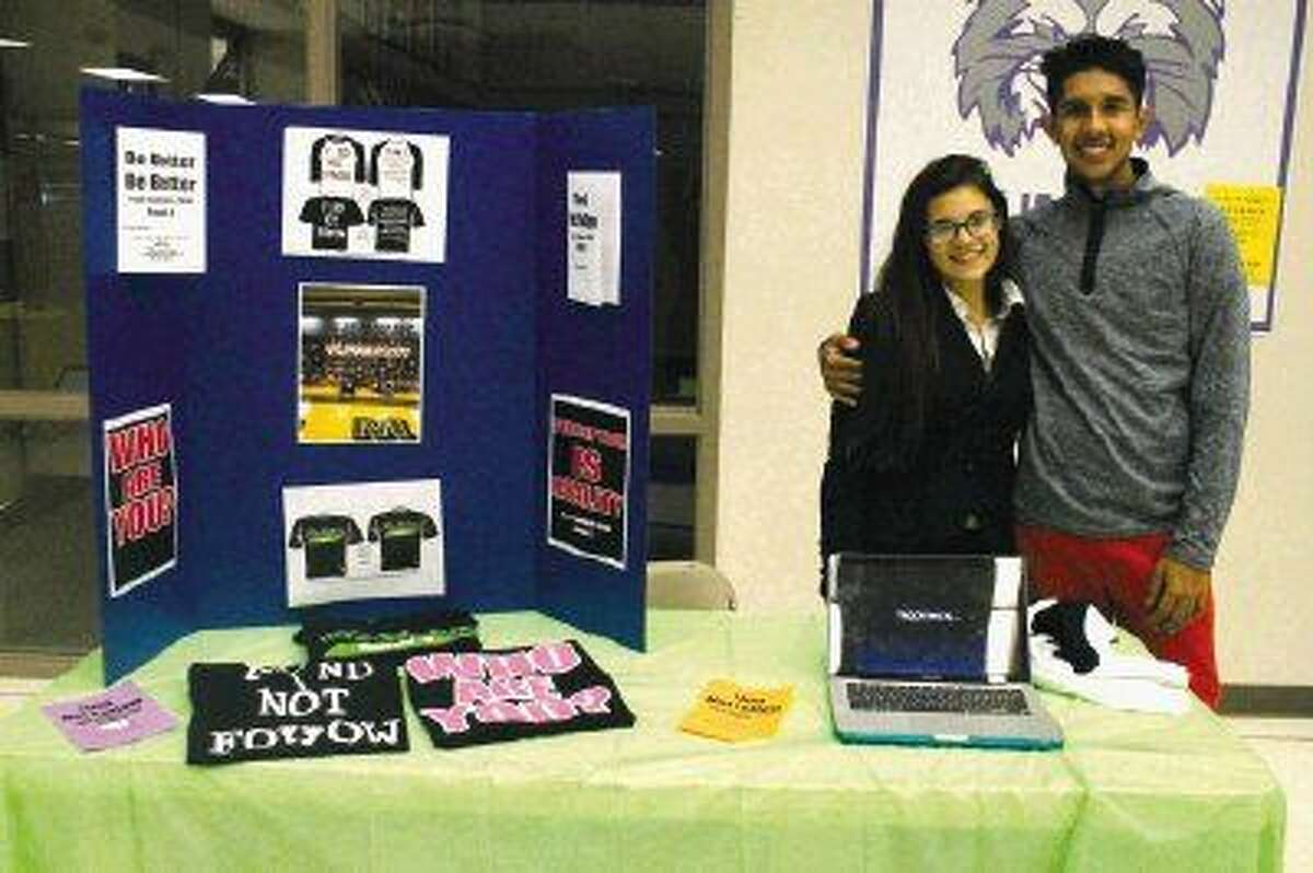 Melinda Calderon and Ruben Zarate, HHS seniors, show their philanthropy project named Teen Summit, an annual student-led event that brings students together to discuss problems recognized on their own campus.