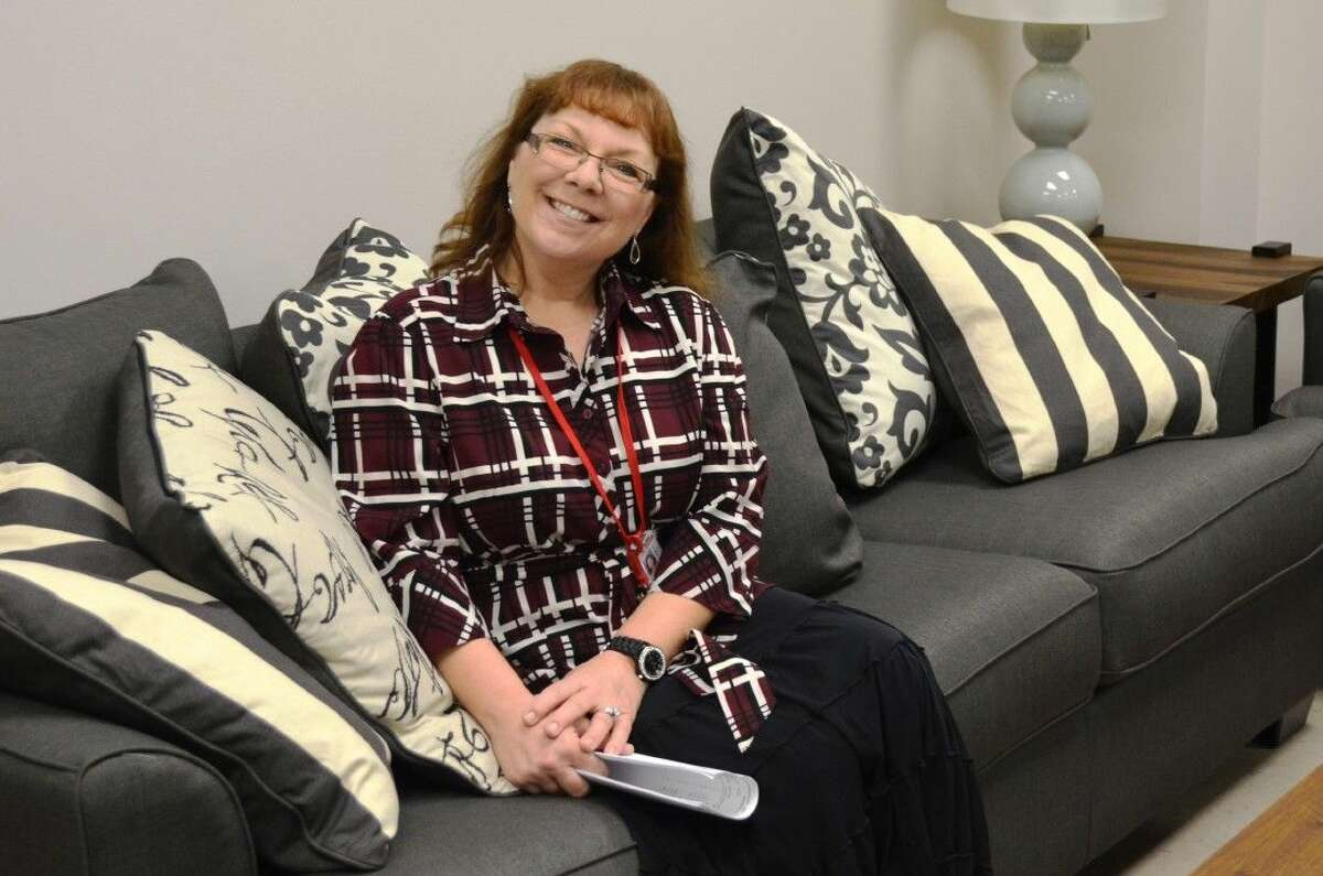 Splendora ISD instructor Rhonda Bell enjoys the new furniture in the high school teachers' lounge, which was awarded to the district by Gallery Furniture on Dec. 8, following a contest win.