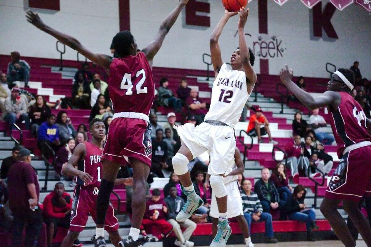 Clear Creek's Nate Jackson (12) tries to put up a shot over Pearland's Gene Harris (42) Tuesday night.