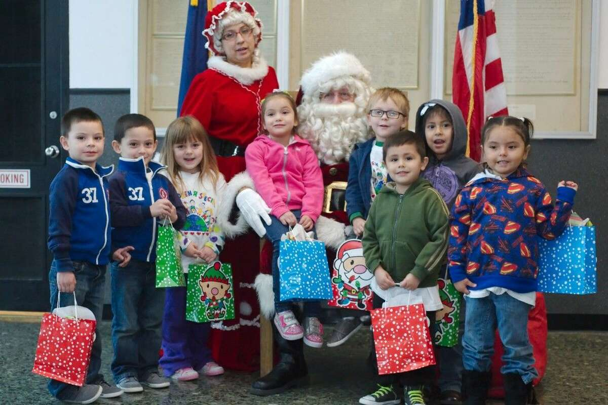Four-year-olds from Children's University pose with Santa and Mrs. Claus after giving their letters to Santa at the Pasadena Post Office on Pasadena Blvd. Tuesday, Dec. 2.