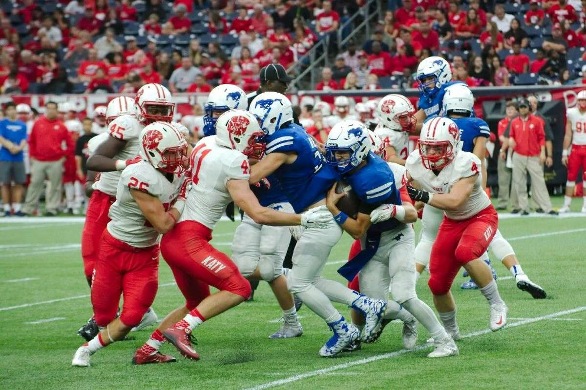 Friendswood's Tyler Page (2) is swarmed by Katy defenders Friday at NRG Stadium.