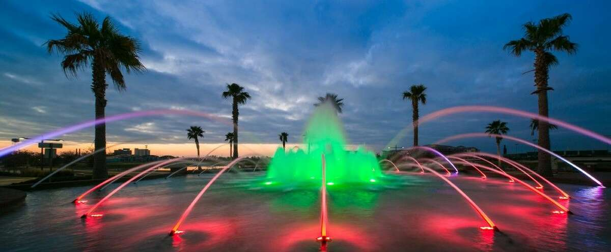 The signature fountain at Imperial Sugar Land inside the community's main entrance on Highway 6 near Constellation Field, brightly lit for the holidays.