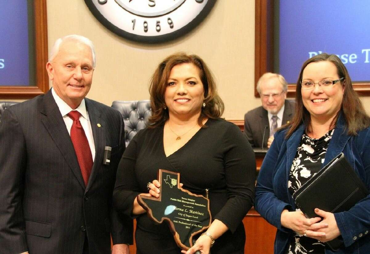 Pictured (L-R) during a presentation at a City Council meeting are Mayor James Thompson, Martinez and Director of Human Resources Paula Kutchka.