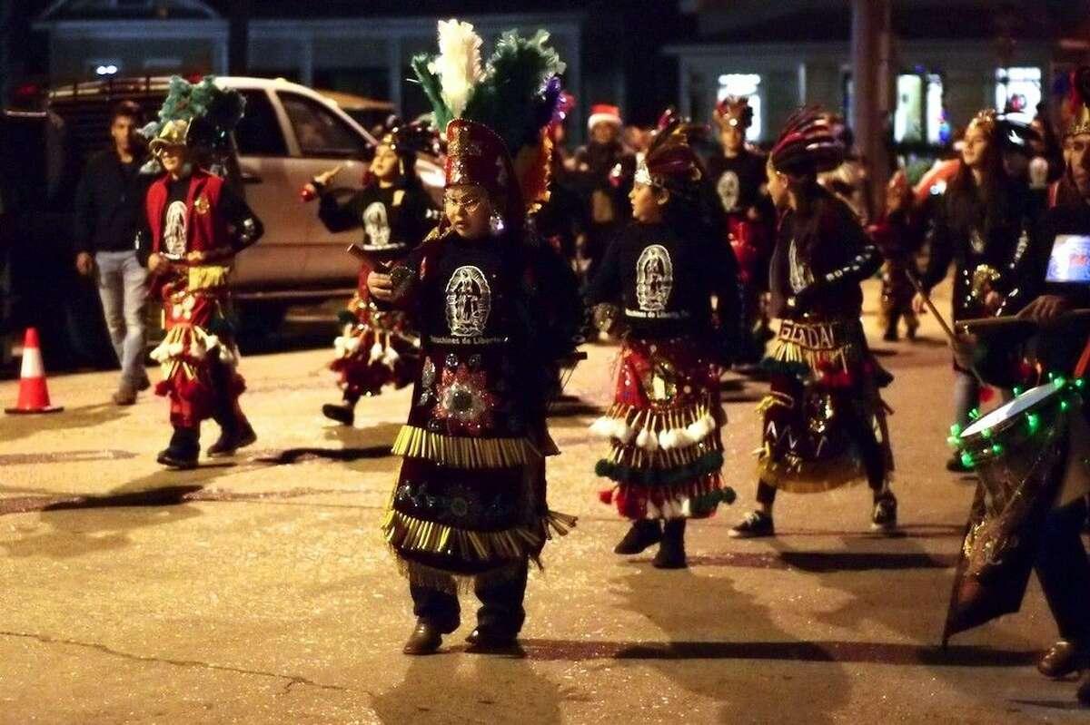 Matachines de Liberty perform in the Christmas parade, Dec. 1, 2015, in Liberty, Texas.