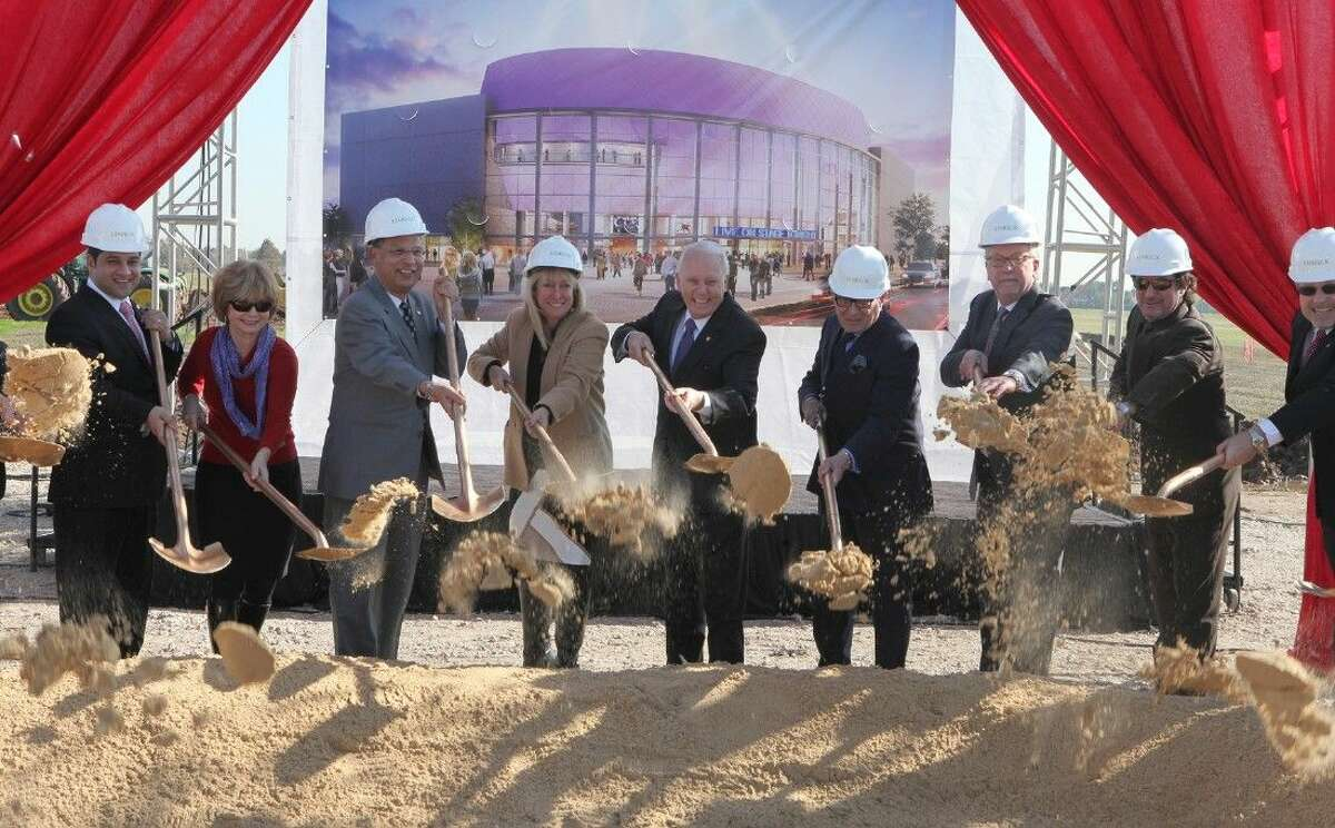 Sugar Land officials including Sugar Land Mayor James Thompson (center) and staff from ACE Theatrical Group Construction break ground on a 6,430-seat live entertainment venue in Sugar Land on Tuesday, Dec. 9.