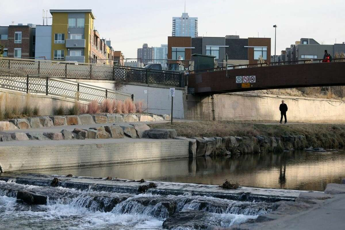 Pedestrians on Monday pass through Confluence Park in Denver, where Cherry Creek joins the South Platte, a key channel in Colorado's water supply.