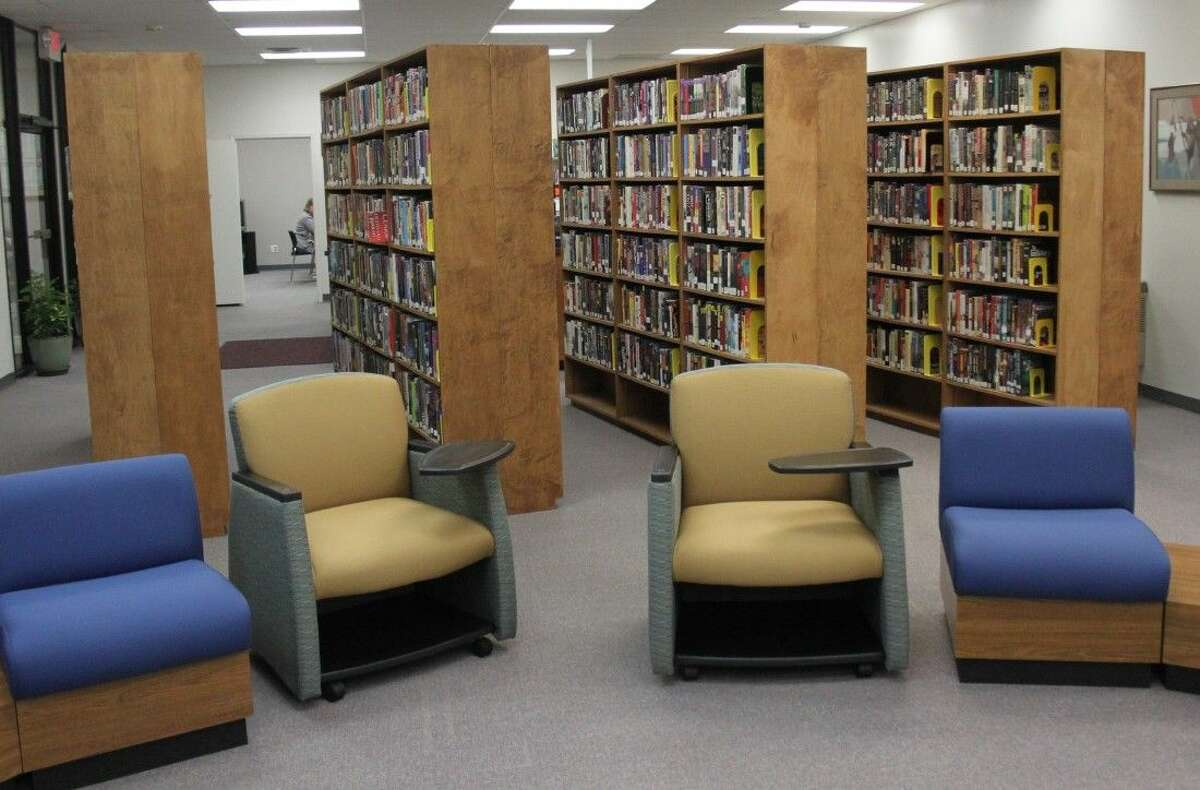 The shelves in Coldspring Area Public Library are now angled and provide a more open environment as well as better visibility as they let in more sunlight.